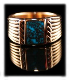 This ring has a beautiful deep blue Spiderweb Turquoise stone from the Lander Blue Turquoise Mine. Lander Blue Turquoise is among the most valuable types of Turquoise in the world. A gold saddle ring from Durango Silver Company is an unusual ring handmade in the American Southwest - made in America! You can see additional photo of this ring by going to its presentation page.  This is a ring style Durango Silver Company originated over 20 years ago and has become a classic for our company,