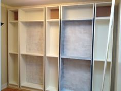 Transforming stock Billy Bookcases into a built-in wall.