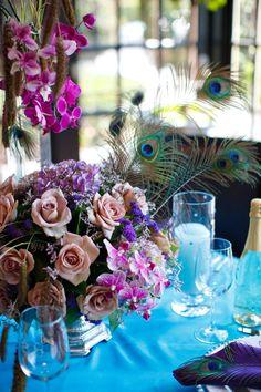 pretty peacock details   wedding floral centerpiece   purple, lavender, blue flowers   Frank Salas, Mina Flower Design via CeremonyBlog.com (3)