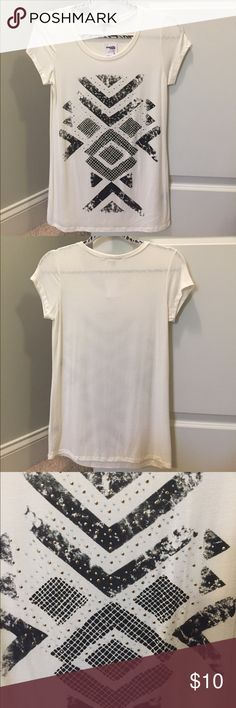 Tan t shirt with design. New with tags Tan t shirt with design. Never worn size M. It was a gift and I could not return it. Tags still on. Charlotte Russe Tops Tees - Short Sleeve