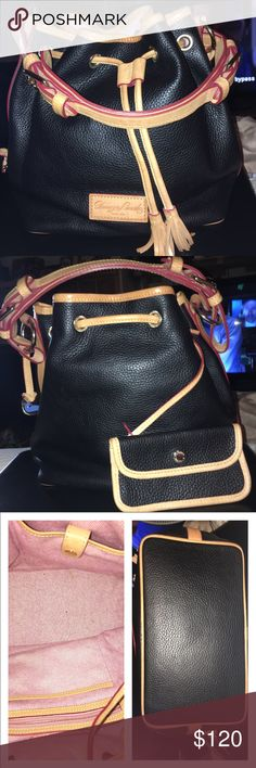 HOST PICKEUC Dooney and Bourke Drawstring Dooney and Bourke GorgeousDrawstring Satchel in Black Pebbled Leather! It is immaculate inside and out! I've used it several times, maybe. The classic Black and Tan leather looks great! Can be used for about most any occasion, It has 1 zip and 3 slip pockets inside, a detachable coin/pouch and it measures 10 X 10 X 6.25 includes dust bagno trades price firm Dooney & Bourke Bags Satchels