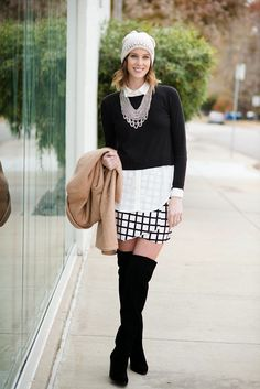 tan coat, black and white sweater, black and white windowpane wrap skirt, over the knee boots, silver bib necklace, embellished beanie