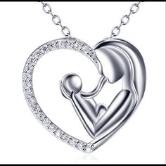 """925 Sterling Silver Mother's Love Heart Necklace Details: Name :925 Sterling Silver Mother and Child Heart Love Charm Cz Pendant Necklace 18"""" ITEM QUANTITY :1PC (Pendant+ chain) Material:All OF Pendant Chain are made of 925 Sterling Silver SIZE:Pendant,0*19mm(0.79inch*0.75""""inch Chain,18""""inches WEIGHT:3.45 grams (Pentant +Chain) STONE:Cubic zirconia STAMPED:S925 CONVERSION:1cm= 0.397inch 1inch =2.54 cm Jewelry Necklaces"""