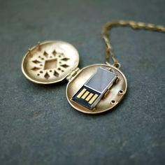 USB Locket by Emily Rothschild. Super cute gift if the usb then had pictures of the friends together, letters, etc :) Bling Bling, By Any Means Necessary, Spy Gadgets, Thanks For The Memories, Locket Necklace, Necklaces, Geek Chic, Flash Drive, Cool Stuff