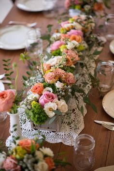 Beautiful vintage lace runner on wood table, mismatched chairs, colorful flowers, great look for rustic or vintage feel wedding decor.