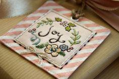 """close up, handmade embroidered """"Joy"""" tag by nanaCompany, J_2752  http://nanacompany.typepad.com/nanacompany/2012/12/2012-holiday-tag-a-long-week-4.html"""