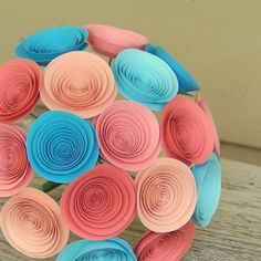 I don't know about paper bouquet but the colors are spot on: Tropical Bouquet in Coral Peach and Aqua  Beach by FlowerThyme, $44.00