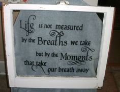An old window with vinyl lettering...what a great idea for re-purpose!