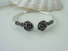 Fabulous plain sterling silver bangle with beautiful flower design details throughout.