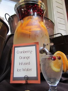 Cranberry and Orange flavored water http://mountainsidebride.com/2011/06/06/signature-drink-month-flavored-waters/