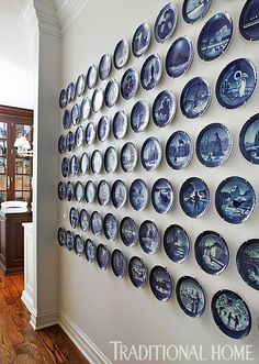 A great collection of blue-and-white plates is displayed in an eye-catching formation.