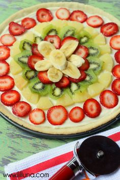 Fruit Pizza family recipe that we've used for years. It's BEYOND delicious! #fruitpizza