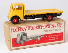 Lot 1942 - Dinky, 512 Guy flat truck, 1st type cab, yellow cab and flatbed, black chassis and wings, red hubs,