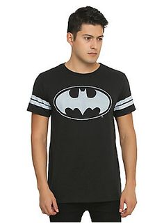 <p>Black athletic inspired T-shirt from DC Comics with a faded <i>Batman</i> logo design & striped sleeves.</p>  <ul> 	<li>50% cotton; 50% polyester</li> 	<li>Wash cold; dry low</li> 	<li>Imported</li> 	<li>Listed in men's sizes</li> </ul>