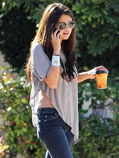 Selena Gomez. Not only is she adorable but she's drinking coffee from McDonald's... Not Starbucks... I love it!!