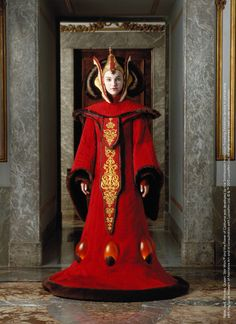 Queen Amidala's Throne Room Gown is one of the most complex creations and shows the influence of Chinese Imperial Court styles. It took almost 8 weeks to complete and the translucent lights at the foot of the gown were powered by a car battery, which was carefully hidden between the actor's legs during filming. Design by: Trisha Biggar #StarWarsCostumes #behindtheseams