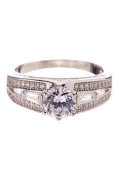 Rhodium plated prong set round, baguette and micro pave simulated diamond split shank ring