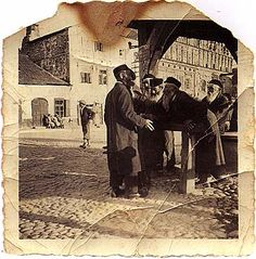 "The market square in Kazimierz nad Wisla. ""This photo was taken in 1936 by Otto Kajper from Krakow, when we were taking part in an outing of technicians from Pionki. The people in the photograph did not know that we were photographing them."" Zygmunt Krawczyk, Sandomierz"