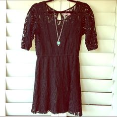3/4 sleeve little black lace dress LBD Comfy 3/4 sleeve black dress that can also be worn with leggings. It is lined with a black spaghetti strap dress under thick lace Dresses Mini