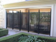 The style and colour of this trellis screen works well in a traditional / formal garden setting