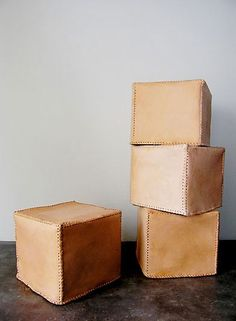 LEATHER OTTOMAN ★ OLIVIER - these would get wonderfully beat up over time.