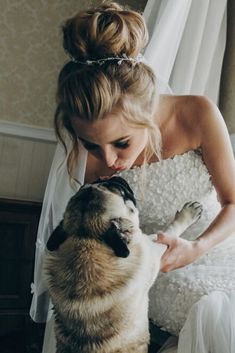 Stylish bride kissing dog in bow tie in soft light near window in hotel room. Gorgeous bride with her pet. Morning preparation before wedding ceremony Cute Pug Puppies, Cute Pugs, Baby Pugs, Before Wedding, Pug Love, Dog Training Tips, Wedding Humor, Cute Baby Animals, Funny Dogs