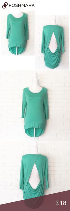"""30% Bundles🌟Mint Open Draped Back Tunic Top ▫️Brand: Mittoshop ▫️Size: S ▫️Material: Rayon/Spandex ▫️Flaws: NONE  ▫️Description:  •Round neck •3/4 length sleeves •Open back •Draped back hem   ▫️Measurements laying flat: •Chest: 18.5"""" •Length: 25""""/ 31""""  ▪️Next Day Shipping ▪️NO Trade/Hold ▪️Smoke Free/Kitty Friendly Home Boutique Tops Tunics"""