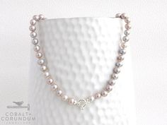 Necklace with beautiful pearls and a 925 sterling silver clasp. These pearls have a stunning light mauve, silver grey colour that is hard to