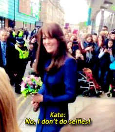 Princess Kate gets instruction from her body guard - No selfies - but the Princess still does them. ;)