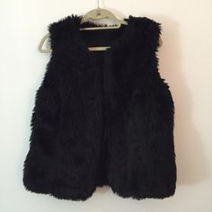 Warm and comfy black faux fur vest faux fur. super cute and comfy. very flattering. perfect for fall/winter. can be dressed up or down. Jackets & Coats Vests