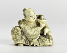 Netsuke of carved ivory, a man sitting holding a gourd in his left hand and in his right a saucer out of which a tortoise is drinking: Japan, Jugyoku, mid to late 19th century