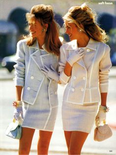 Jackie O style tailored pastel suits with white trim and matching gloves and handbags