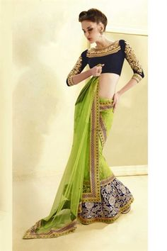Amazing green color lehenga style saree - Bottom portion of the skirt is worked with stones and kundan worked motifs are inter spread all over the saree. Blouse is heavily engraved with zardosi , beads and thread work.