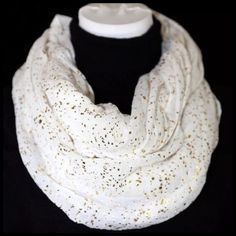 "B5 White Infinity Scarf With Metallic Gold Spec Metallic Spec Scarf ‼️ PRICE FIRM UNLESS BUNDLED WITH OTHER ITEMS FROM MY CLOSET ‼️  Photos do not capture how gorgeous this scarf is.  Gold metallic specs on a white soft fabri. 27' X36'.  100% polyester.  Please check my closet for many more items including jewelry, scarves, designer clothing, handbags shoes & more!   28"" wide  35"" long Boutique Accessories Scarves & Wraps"