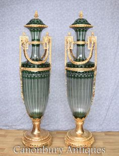 - Stunning pair of French Empire cut glass and ormolu urns<br /> - This architectural pair stand in at nearly five feet tall so very impressive!<br /> - They are the classic campana shape <br /> - Stunning collectors piece, can you imagine how these would look set up in your home?<br /> - Will ship to anywhere in the world<br /> - Come view these in our Hertfordshire warehouse yourself - please email for an appointment<br /> -...