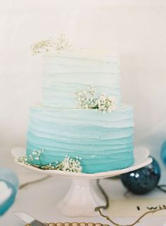 Love this sweet blue ombre wedding cake