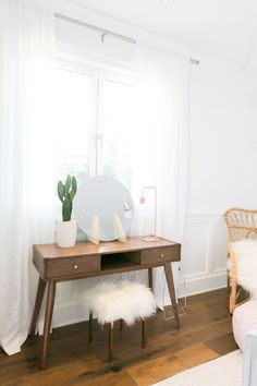 This vanity, complete with a DIY mirror and sheepskin stool, is every makeup lover's dream set up.