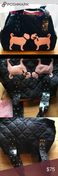 My Flat in London vintage pug dogs handbag I'm parting with my black and pink bag with 2 pink pug dogs 🐕 on the front one has their bling the other has lost hers) it's not really noticeable looks like a male & female pug couple lol! ... cool studded sturdy handles. Inside there's a pink coin purse attached by a cord.. has many pockets inside the only issue with this bags otherwise great condition is the inside needs cleaning.. made of nylon, leather handles studded with silver balls. I…