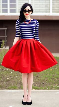 Marine style jersey top with a funky red skirt. Great style for pear shape ladies and everyone else who likes to go 50s