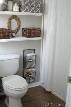 open shelves above the toilet and on the wall by mariana