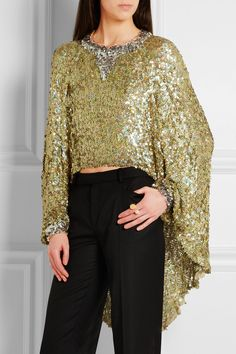 INSPIRATION & TAKE-AWAY: Sonia Rykiel sequin pullover. The take-away is, a garment higher in the back than the front. This is flattering because otherwise it would be an all-over blocky look of sequins. Hard to find info on the Internet, but this opens in the back and fastens with a button.