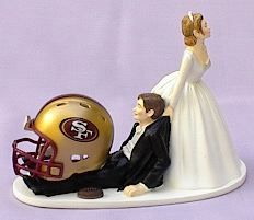 I LOVE IT.. but I think it might be the groom pulling away the bride :D  LOVE THE NINERS!!!