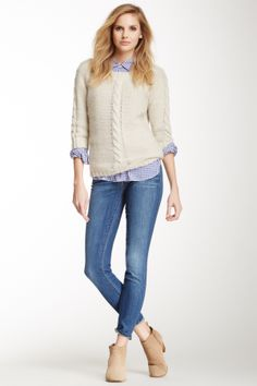 Skinny jeans and cable sweater