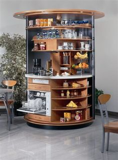 This circle kitchen is genius.  Complete area can be reached from sitting or standing position, 180° rotating inner ring, 360° rotating upper shelf, all amenities of a full kitchen and storage capacity equivalent to 12 average cupboards. PERFECT for cram packed apartments or affordable housing complexes. INCREDIBLE DESIGN SOLUTION!