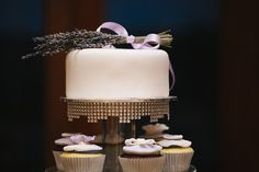 White cake with a lavender bunch...so simple, so beautiful!  Winter Wedding at Millbrook Winery from White Tulip Photography