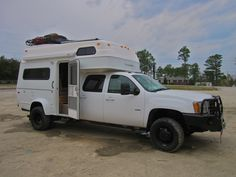2009' GMC 3500HD Duramax/Allison Dually Diesel with Tiger Class C Motor home.  The Provan Tiger is a lightweight, durable welded aluminum framed camper that supports surrounding wood, fiberglass, and insulation. The unit is toped with a one piece fiberglass roof.  The raised roof provides int