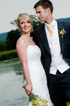 My handsome groom wore charcoal tails with a plain ivory waistcoat