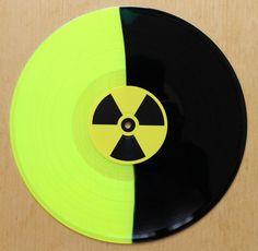 Toxic Holocaust – Evil Never Dies yellow & black split vinyl