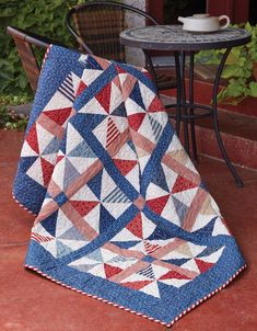 "Everyone loves patriotic quilts, like Summer Picnic by Tricia Lynn Maloney. Pinwheels and Americana colors make this patriotic quilt pattern a great ""blanket"" for watching fireworks on the 4th of July and an appealing throw-size quilt for your home."