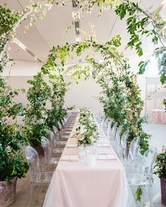 Juliette and Dino's reception took place in a private indoor area, which was decorated with greenery and vine arches, mimicking their…
